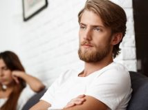 Upset handsome man in quarrel with his girlfriend background.
