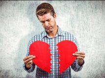 Composite image of sad man holding a broken card