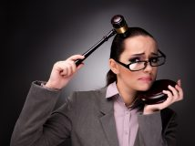 Woman judge with gavel in justice concept
